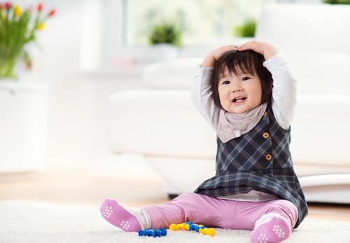 Kids playing on a carpet