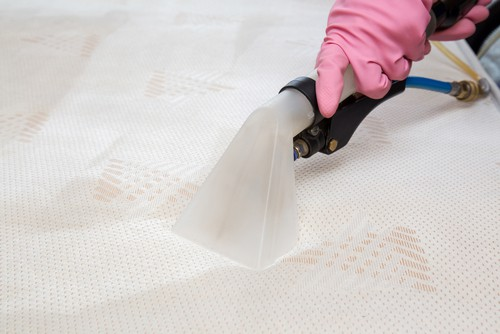 Mattress cleaning in progress